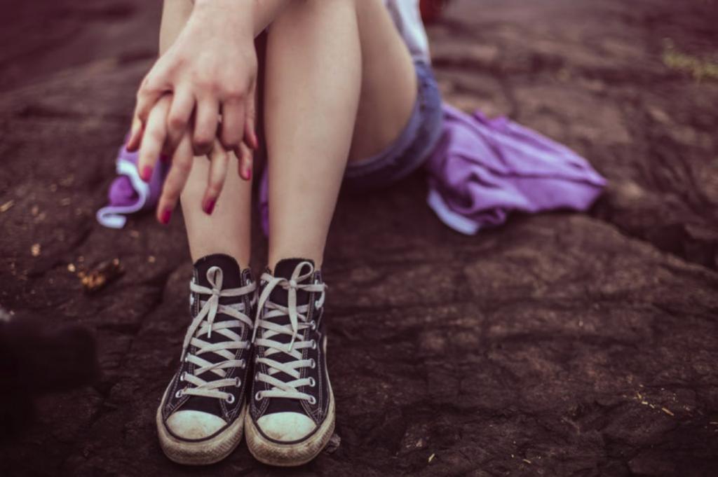 teen sitting in sneakers